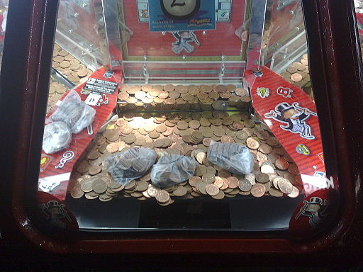 2p_coins_on_pusher_at_Butlins,_Minehead_2009