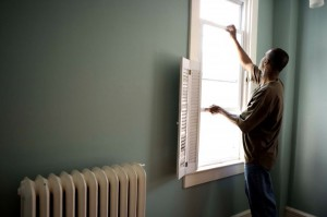 african-american-man-stands-next-to-open-window-725x483