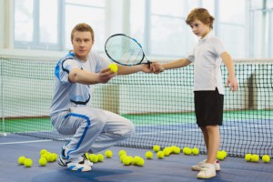 shutterstock_405189829_Tennis-Coaching_Small-821x548